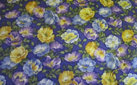 Blue, Purple, Gold Flowers on a Blue Background
