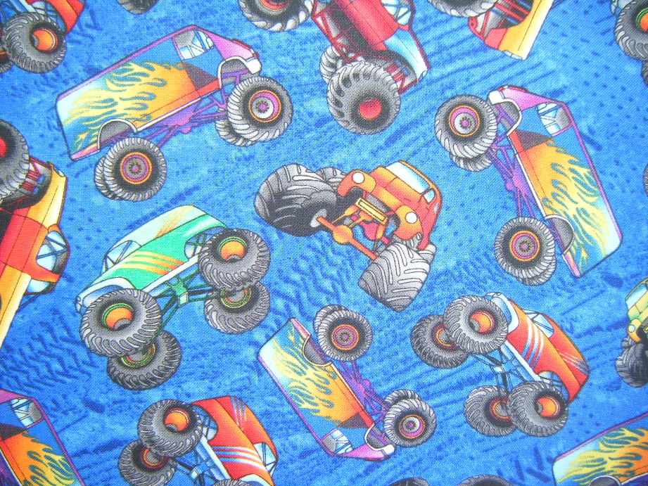 Monster Trucks in Bright Colours on Royal Blue Background - Click Image to Close