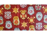Fire Department Badges on a Burgundy Background